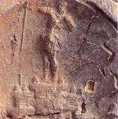 Πήλινο σφράγισμα από το λόφο Καστέλι στην πόλη των Χανίων. Εικονίζεται μινωικό ανάκτορο ή πόλη και ο προστάτης θεός ή άρχοντας (λεπτομέρεια)